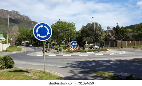 Roundabout sign with roundabout, Hout Bay near Cape Town, Western Cape, South Africa