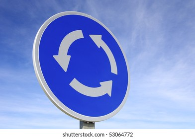 roundabout signal with blue sky