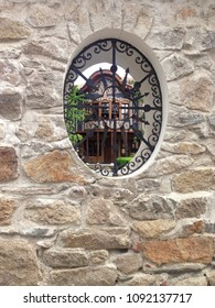 Rounded Old window frame with wrought iron