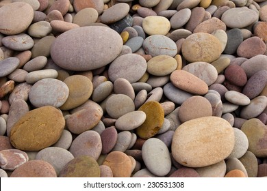 Rounded pebbles at the beach