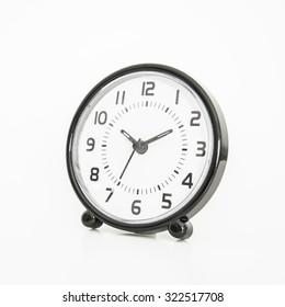 Rounded shape alarm clock on white background