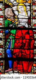 Roune, France - February 10, 2013: Stained glass window depicting Saint Agatha in the Cathedral of Rouen, France.