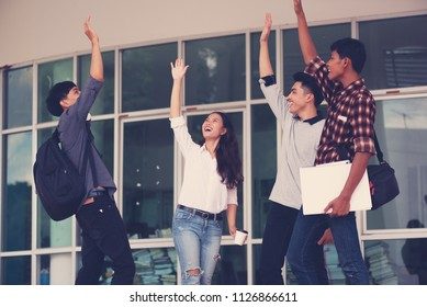 roup of cheerful students  with raised hands in the campus, Students team celebrate victory success goal achievement happy smile,Education concept.