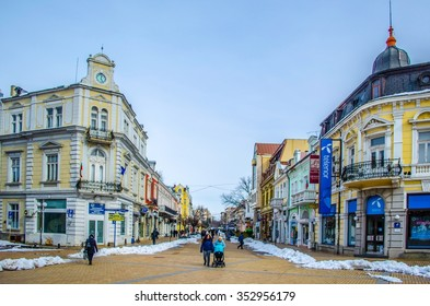 ROUSSE, BULGARIA, FEBRUARY 22, 2015: People are passing through the main square of bulgarian city rousse during cold day in february 2015.