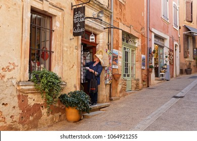 ROUSSILLON, FRANCE, April 6, 2018 : A gift store in a small street of the village. Luberon is a favourite destination for visitors because of the pleasant and picturesque towns and villages.