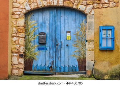ROUSSILLON, FRANCE - DECEMBER 6, 2015: Blue door in the hilltop village of Rousillon, Provence, France