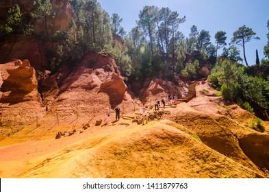 Roussillon, France - June 14, 2018. The Ochre Path le Sentier des Ocres through the Red Cliffs of Roussillon Les Ocres, a nature park in Vaucluse, Provence, France