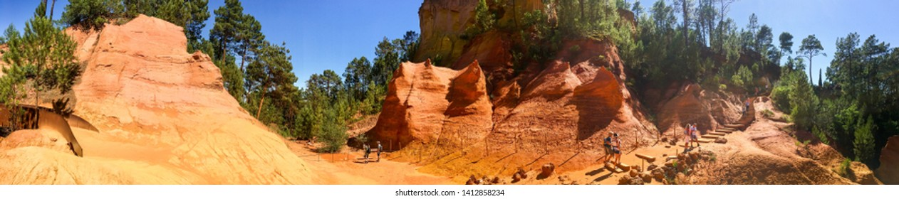 Roussillon France - June 14, 2018. Ochre Path le Sentier de Ocres through Red Cliffs of Roussillon les Ocres, nature park in Vaucluse, Provence