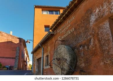 Roussillon, France — June 24, 2018: Giant ancient millstone