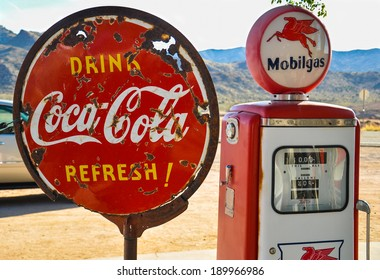 ROUTE 66, AZ, MAY 15: Retro gas pump and a rusty coca-cola sign on historic route 66 in Arizona on May 15, 2013
