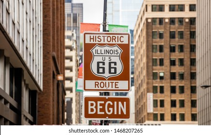 Route 66 Illinois Begin road sign at Chicago city downtown. Buildings facade background. Route 66, mother road, the classic historic roadtrip in USA