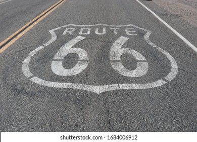 """Route 66"" marked on the pavement."