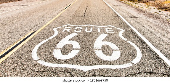 Route 66 road sign. Historic street with nobody. Classic concept for travel and adventure in a vintage way.