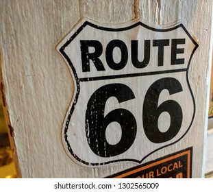 Route 66 sign on door of Radiator Springs gas station outside Oatman, Arizona