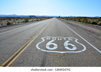 Route 66 sign on the road in Amboy, California. - Shutterstock ID 1304924791