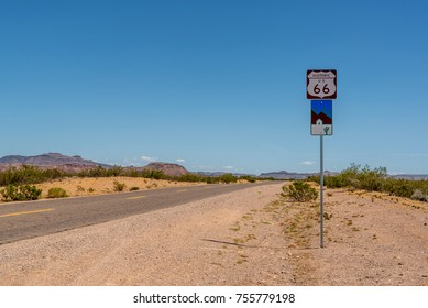 Route 66 sign on the side of the road in the desert in Arizona