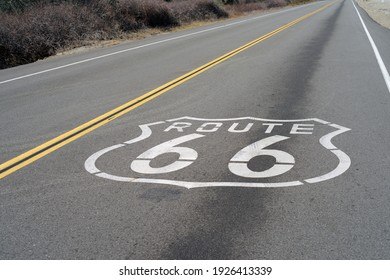 Route 66 sign painted on a road in Southern California.