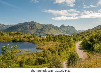 Route E10 winding through typical landscape on Lofoten islands in northern Norway. Lofoten is a popular tourist destination.