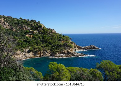 The route from Sant Feliu de Guíxols to Tossa de Mar, Costa Brava, Spain - beautiful car/ bike route along the coastline with breathtaking views. Blue water with boats and yachts and hidden beaches.