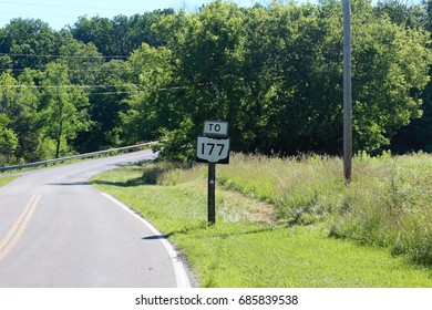 The route sign on the winding country road.