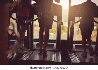 Routine. People working  together exercise in gym.