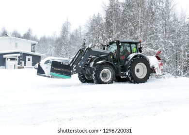 ROVANIEMI FINLAND CIRCA JANUARY 2019. Snow removal machines on road after recent snowstorm in the Arctic town, are well prepared for winter weather and responding quickly