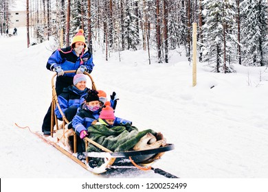Rovaniemi, Finland - March 3, 2017: Family with children riding Husky dog sled in Finland in Lapland in winter.