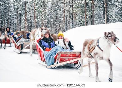 Rovaniemi, Finland - March 3, 2017: Girls at Reindeer sleigh in Finland in Lapland in winter.