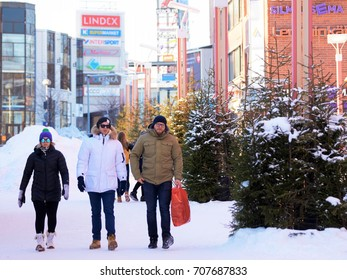 Rovaniemi, Finland - March 4, 2017: People passing by Lordi Square in winter Rovaniemi, Lapland, Finland.