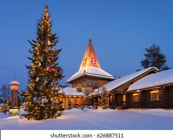 Rovaniemi, Finland - March 5, 2017: Santa Claus Office in Santa Village with Christmas trees illuminated at night, Lapland, Finland, on Arctic Circle in winter.