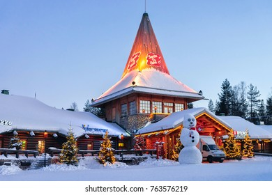 Rovaniemi, Finland - March 6, 2017: Snowman at Santa Office in Santa Claus Village, Rovaniemi, Lapland, Finland, on Arctic Circle in winter. In the evening. Outdoor
