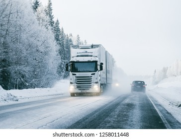 Rovaniemi, Finland - March 7, 2017: Truck at the Snowy winter Road in Finland, Lapland.