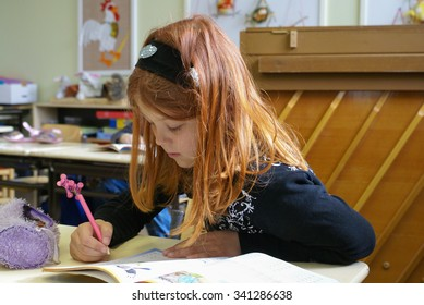 Rovaniemi, Finland - May,  2007:  Small girl does exercises from mathematics at primary school in Finland. Documentary editorial