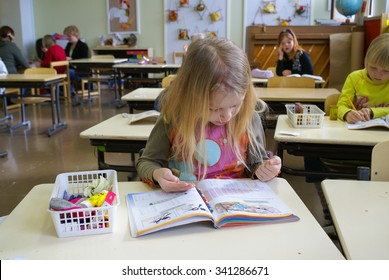 Rovaniemi, Finland - May, 2007: Young girl counts numbers with help of her hands during the lesson of mathematics at primary school in Finland. Documentary editorial