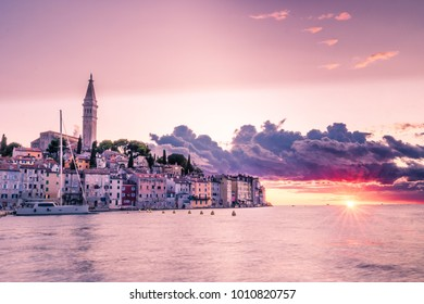 Rovinj Croatia beautiful colorful old town of Rovinj on a summer evening during sunset hours with stormy clouds