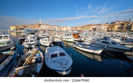 Rovinj, Croatia - December 6, 2018: View of the harbor of city of Rovinj in Croatia.  Boats in front of colourful houses. Long view