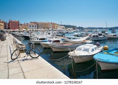 ROVINJ, CROATIA – JULY 18, 2018: Boats in the port of Rovinj on the Croatian Adriatic coast. Rovinj is one of the most popular port cities in Istria, a part of Croatia.
