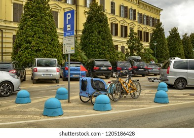Rovinj, Istria, Croatia. August 2018. A bike with baby carrier was parked in an original way: in the middle of a traffic island.