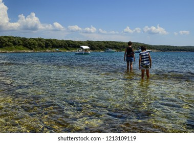 Rovinj, Istria, Croatia. August 2018. Natural oasis of Palù, a swamp formed in a depression of the land near the sea. The stretch of sea in front of the marsh is heavenly. Crystalline water attracts