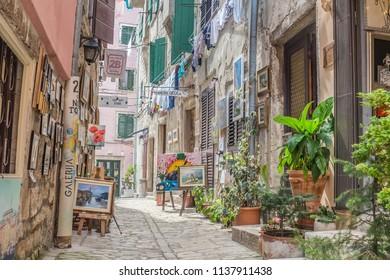 ROVINJ, ISTRIA PENINSULA, CROATIA - may 2018: cityscape. walking charming narrow stone street in historical center of Rovinj, Croatia