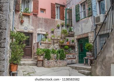 ROVINJ, ISTRIA PENINSULA, CROATIA - may 2018: cityscape. walking charming narrow stone street in historical center of Rovinj, Croatia. view of small cozy patio