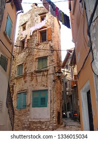 Rovinj, small town in Croatia, on Adriatic coast. Narrow streets and tight buildings, with loundry drying above passengers heads.