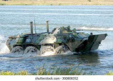 Rovno, Ukraine - 17 September 2007. APC BTR-80 crossing the river on maneuvers.