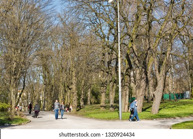 ROVNO, UKRAINE - APRIL 09, 2018: Unrecognized people walk in the Taras Shevchenko early spring park. Rovno or Rivne is a historic city in western Ukraine and the historical region of Volhynia.