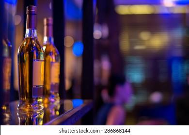 row of alcohol bottle on wooden shelf in fine dining restaurant