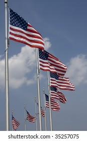 Row of American Flags around the Washington Memorial in the US Capital