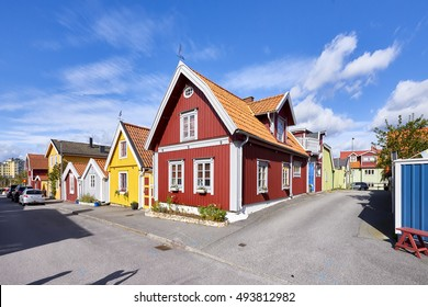 Row of ancient colorful wooden houses in the city of Karlskrona, Sweden