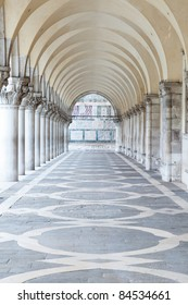 A row of arches underneath the Doge's Palace in Piazza San Marco in Venice.