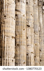 A row of architectural columns in Rome, Italy