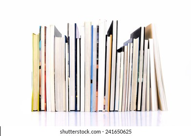 Row of art magazines on white background
